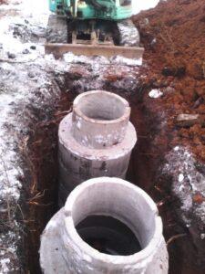 установка кессона в скважину зимой
